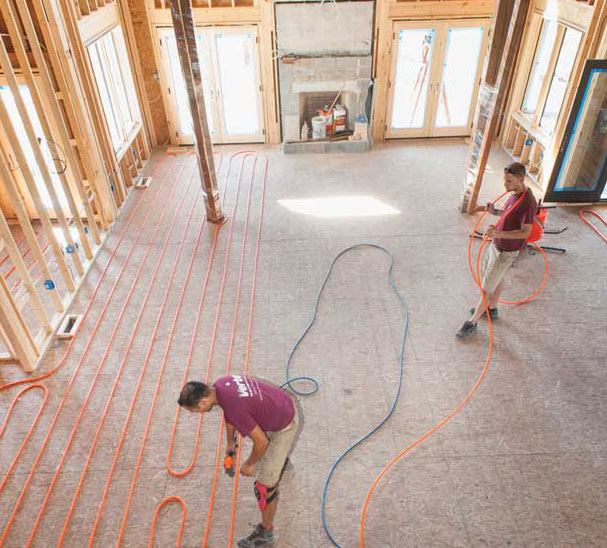 Installing radiant heating in a barn-turned home dating from the 1800s. - The ACHR News