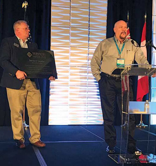 David Rothacker, Go Time Success Group, thanks the International Roundtable audience from the podium. Matt Michel, president, Service Nation, Inc. presented Rothacker with the Servant Leader Award. - The ACHR News