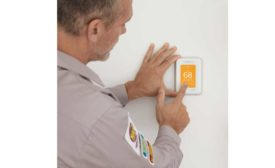 Here, a contractor installs Resideo's Honeywell Home T10 Pro Smart Thermostat. - The ACHR News