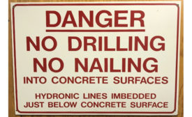 Sign printed with a warning of the radiant tubing installed under the floor.