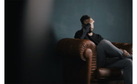 Worried-man-in-chair