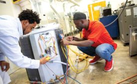 Two apprentice students at Santa Fe College's Heating & Air Conditioning Apprenticeship certificate program.