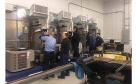 Employees at Chapman Heating and Cooling get a look at the latest products the company offers.