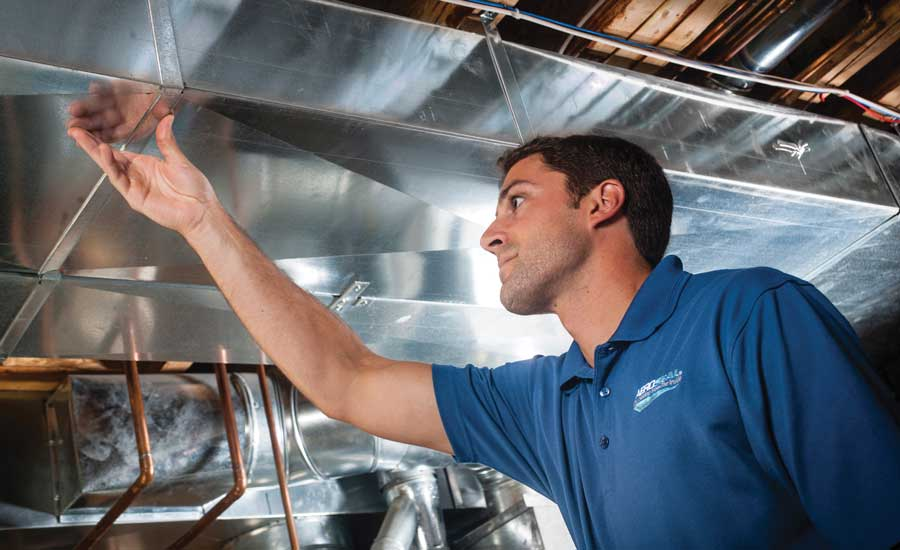 Technician checking the ductwork before beginning the sealing process.