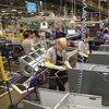 Goodman employees work to manufacture highend equipment.