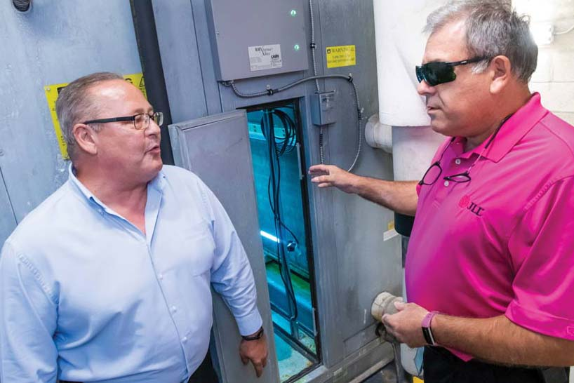 Bruce Fontaine (at left), formerly with Sustainable Management Solutions, discusses the RLM Extreme UV germicidal lamps system with Miki Minic, senior chief engineer at Jones Lang LaSalle.