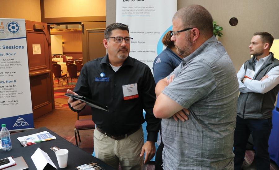 A contractor at last fall's ACCA event asks questions of a representative from 3C Connect.