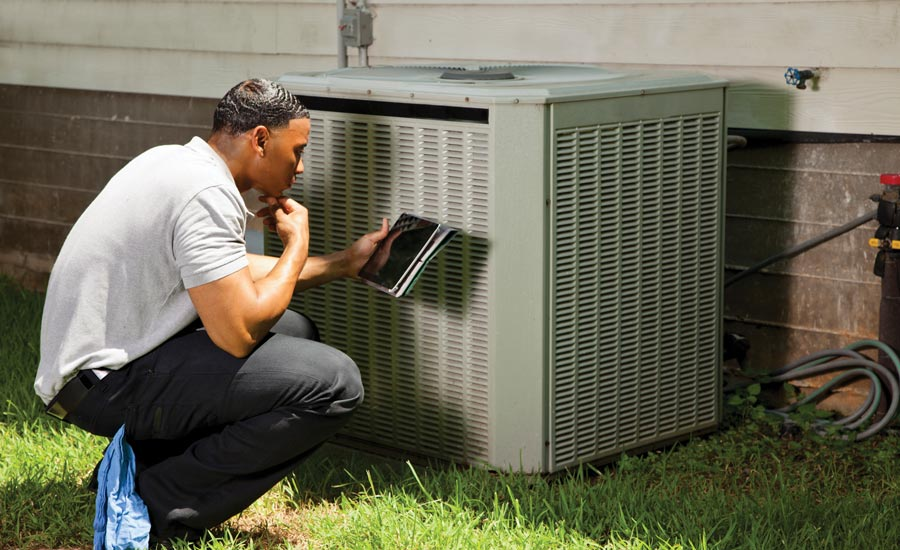 Air conditioning system and technician.