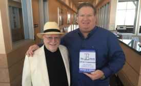 """Goettl Air Conditioning & Plumbing CEO Ken Goodrich, at right, poses with co-author Michael E. Gerber to show off this new book """"The E-Myth HVAC Contractor"""" at Service World Expo."""