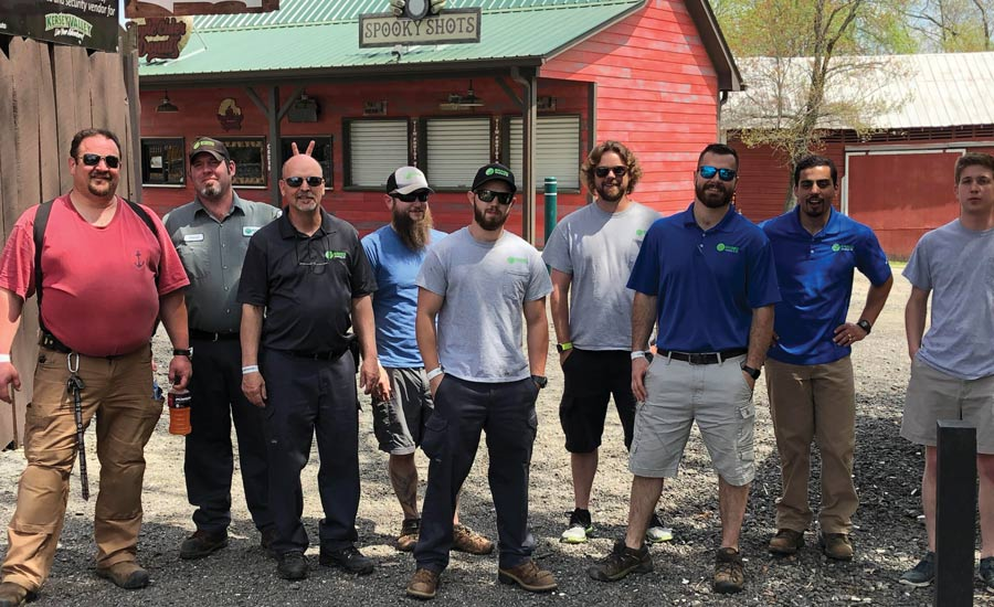 Service technicians and installers at Eanes take part in some very competitive team-building activities, including laser tag and axe throwing.