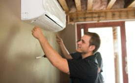 A Restivo's technician installs a ductless unit for a client.