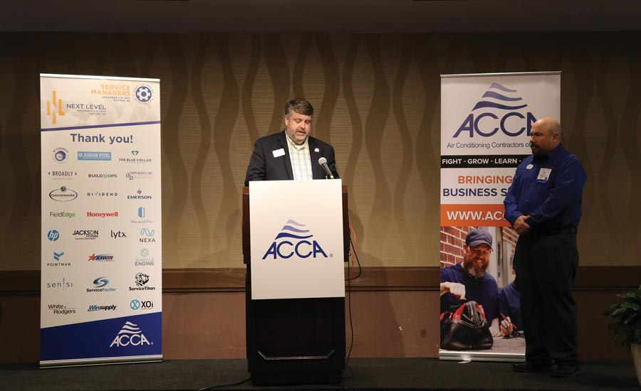 James introduces Craig Sabol, the 2019 Service Manager of the Year, at an ACCA event last fall.
