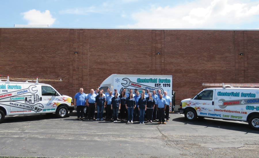 The staff at Chesterfield Service stands in front of the company's fleet of trucks.