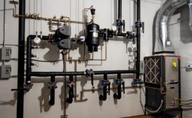 A geothermal mechanical room displays a selection of geothermal technology for contractors to learn, understand, and convey the benefits of to their customers.