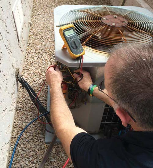 Technicians at Green Integrated Design are prompted perform system tests after installation.