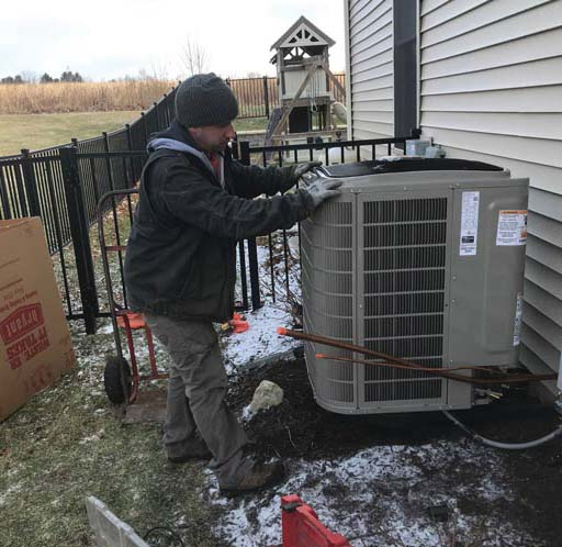 Peter Turek, lead installer at Orange Home Services, installs a new system.