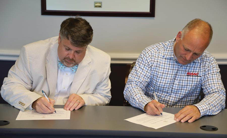 James joins Eric Knaak of Isaac Heating and Air Conditioning in signing the Pledge to America's Workers during a White House event last summer.