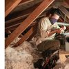 A tech installs an Aprilaire unit in an attic.