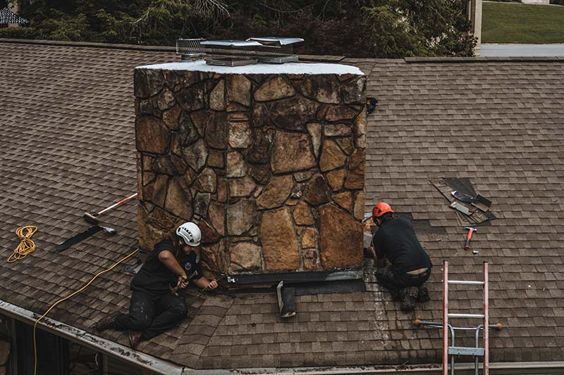 A crew from TN Fireplace & Chimney works on a commercial chimney project.