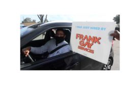 A successful applicant at the Dec. 10 drive-through hiring event at Frank Gay Services celebrates his hiring.