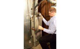 Technician Measuring Static Pressure.