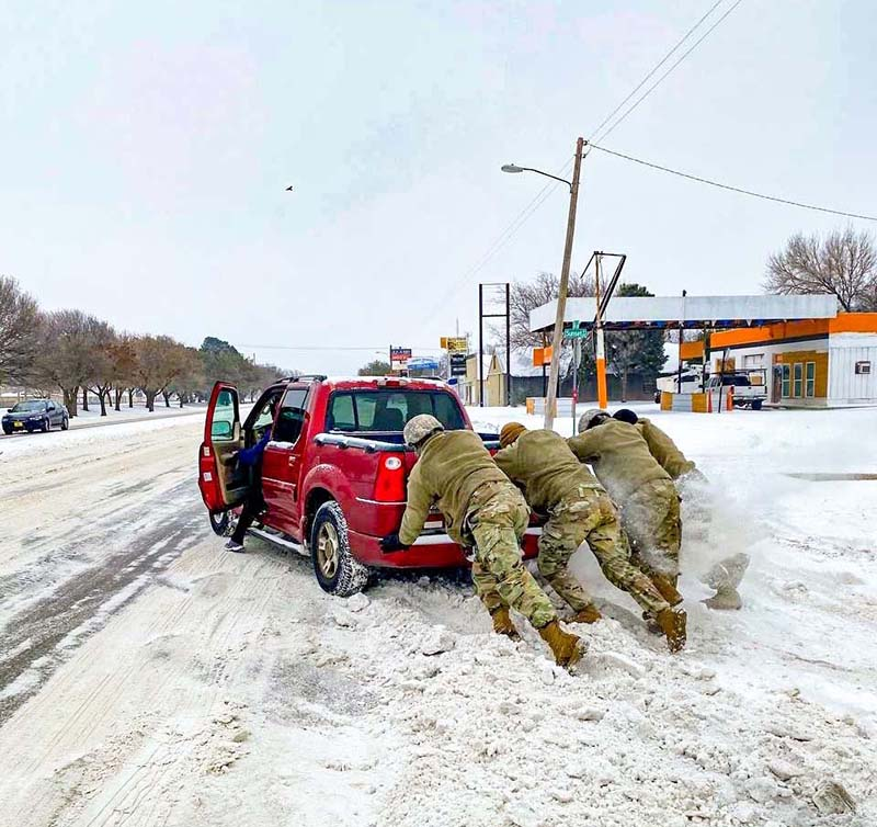 Members of the National Guard teamed up to help a driver during last winter's ice storm in Texas.