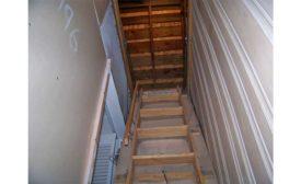 Pull-down ladder for safer service work in attics.