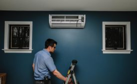 A technician installs a ductless unit in a consumer's home.