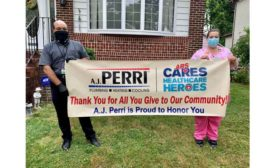 Andrew Gamatko, plumbing manager for A.J. Perri, and nurse Carla Biondi stand in front of Biondi's home.