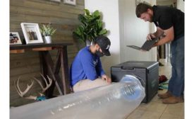 Technicians check to see how leaky a duct system is. Aeroseal products will cover most of the leaks.
