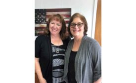 Suzi Zwick (dispatcher), left, and Liz Peterson (accounting), right, from Air Comfort Heating and Cooling.