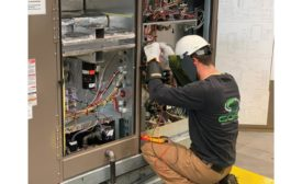 A technician works on a chiller.