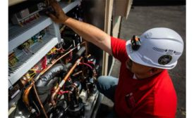 A technician from Jett's Specialty Contracting works on a unit at an elementary school.