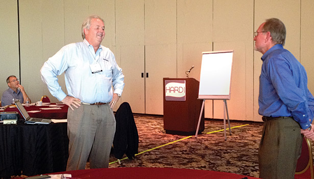 Norm Clark interacts with a participant during his session about developing high-performance sales.