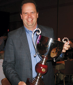 Thermostat Recycling Corp. (TRC) awarded Johnstone Supply the 2013 Big Man On Planet (BMOP) title and trophy
